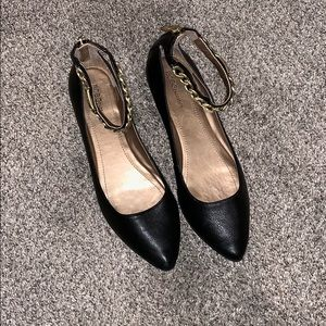 BCBG women's black and gold flats